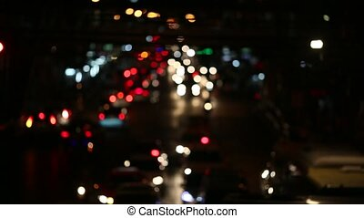 Night city lights and traffic. Blurry unfocused city lights...