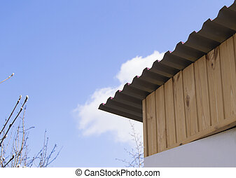 The roof of the house and  blue sky