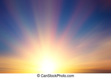Beautiful sun with rays at sunset.