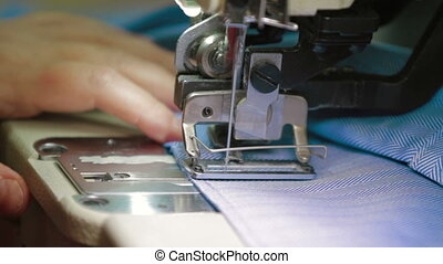Working part of industrial sewing machine - close up on...