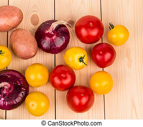 Yellow and red tomatoes onion on the wood Whole background