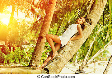 Woman on palm tree