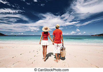 Couple on a beach at Seychelles - Couple relaxing on a...