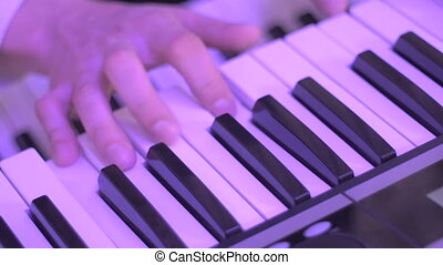 Close - Up Shot of Male Hands Playing of Synthesizer on The Party