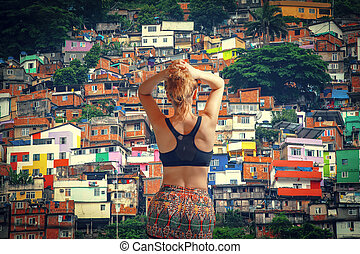 girl athlete. Colorful painted buildings of Favela in Rio de...