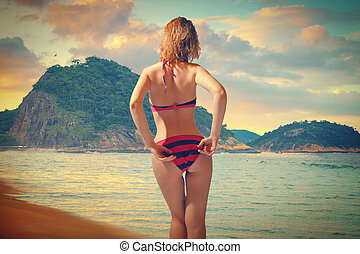Copacabana beach - girl in a bathing suit came out of the...