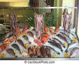 Fresh seafood arrangement displayed in beach restaurant