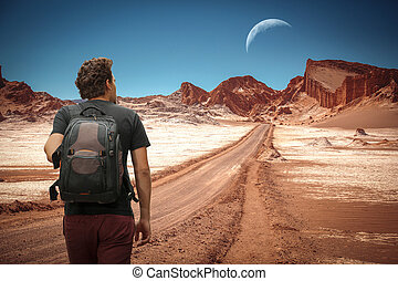 The moon in the Moon Valley. - tourist man traveling in the...