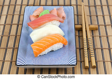 Sushi - Japanese sushi on a plate with chopsticks