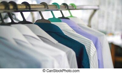Female Tailor taking new shirt