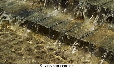 Water on paving stones. Slow motion