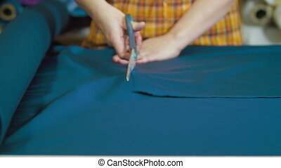 Tailors cutting supplies for sewing shirt - Stock Footage...
