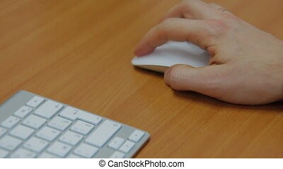 hand clicking computer mouse - male hand clicking computer...