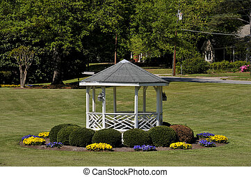 Gazebo - A gazebo in a front yard with flowers