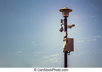 The Big brother - Surveillance cameras on street lamp.