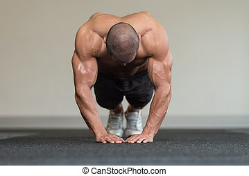 Healthy Man Doing Press Ups In Gym - Healthy Athlete Doing...