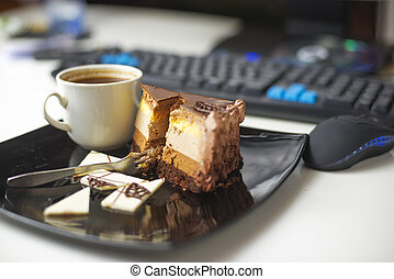 Dessert-slace of cake - Slice of cake on plate with cup of...