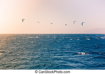 Windsurfers sailing in the Red Sea Near the beach of Eilat,...