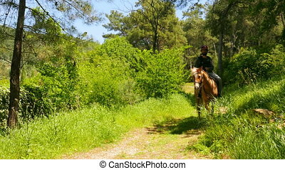 quot;man learning horse riding, outdoorquot; - man learning...