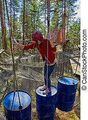 Teen Girl in a Forest Rope Park