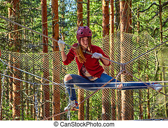 Teen Girl in a Forest Rope Park Challenge