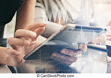 Closeup photo female hands holding modern tablet. Account managers working new private banking project office. Using electronic devices. Graphics icons, worldwide stock exchanges interface. Horizontal