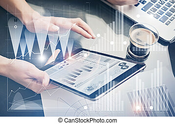 Photo female hands holding modern tablet.Account managers working new private banking project office.Using electronic devices. Graphics icons, worldwide stock exchanges interface on screen. Horizontal