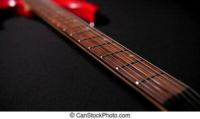 Red Guitar on a Black Background 2