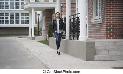 Beautiful leggy blonde confident gait walking down the...