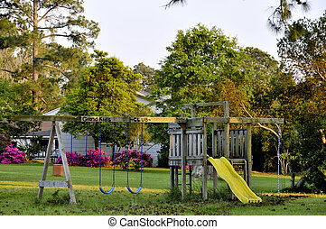 Swingset - A swingset in the back of a yard