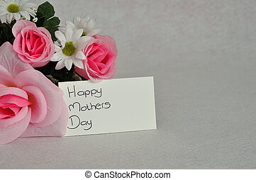 Mothers day - A bunch of artificial flowers with a card for...