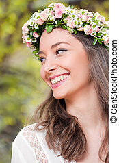 Gorgeous brunette woman wearing spring flower wreath -...