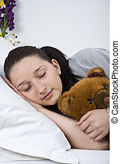 Sleeping young woman with teddy bear - Close up of young...