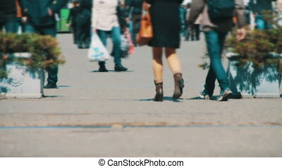 Anonymous People Walking on the Street Defocused Crowd feet...