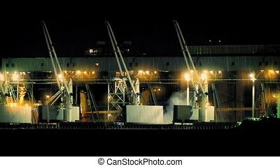 Industrial Cranes At Night In Rain - Industrial area with...