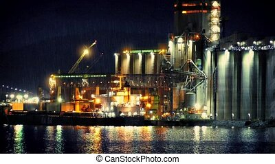 Refinery At Night In Rain - Oil refinery plant by harbor on...