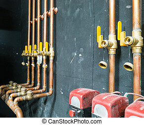 Row of copper pipes and valves
