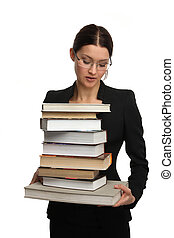 girl holding a large pile of books