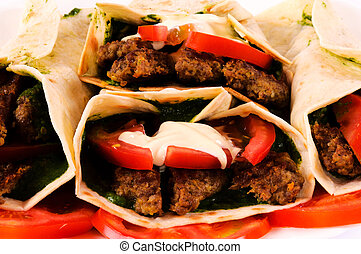 Bunch of gyros pita and vegetables