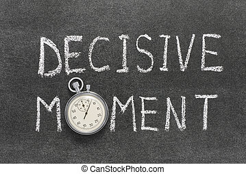 decisive moment phrase handwritten on chalkboard with...