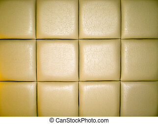 Pale Tan Leather Upholstry Background with a Repetitive...
