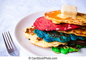 Colorfull pancake - Colorfull homemade pancakes with melted...