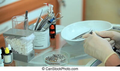 Dentist Working With Instruments - CLOSE UP shot of a...