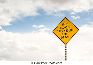 When flooded turn around. Road sign