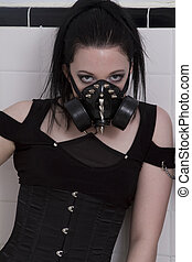 Goth girl with gas mask - teenage girl wearing gothclothes...
