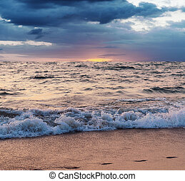 Sea and beach storm with color of the sunset in twilight