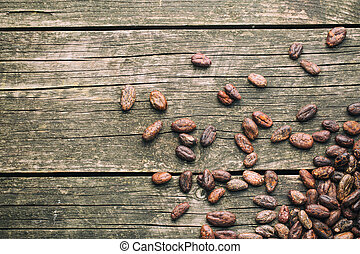 cocoa beans on wooden table