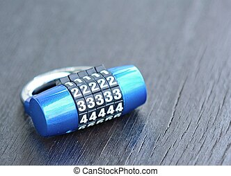 Combination lock - New blue metal combination lock on dark...