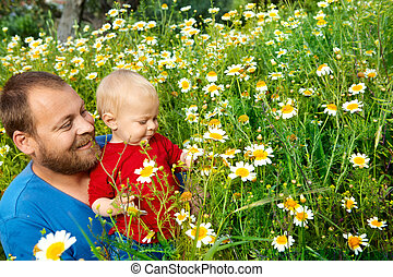 father and son in flowers