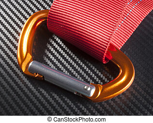Carabiner - Orange carabiner with red nylon on a graphite...